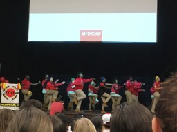 City Year members do a dance during the kick-off to the volunteer event. (Photo credit: Julia Wolf)