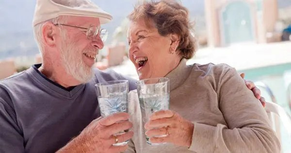 blog picture of elderly couple enjoying each other while drinking water