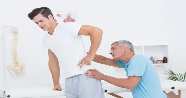 blog picture of man getting checked by a chiropractor