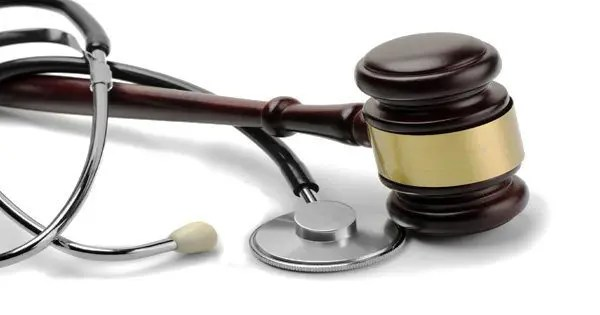 blog picture of stethoscope and gavel intertwined