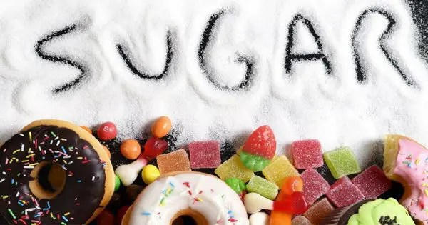 blog picture of donuts and candies with sugar spread out with the word sugar written in it