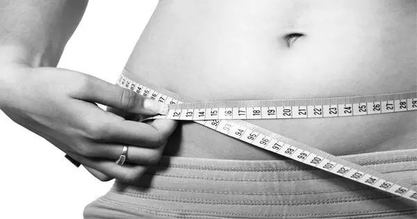 blog picture of woman measuring her belly
