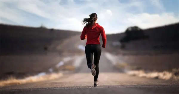 blog picture of lady running in the middle of the road