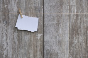 A white notecard attached to a clothesline