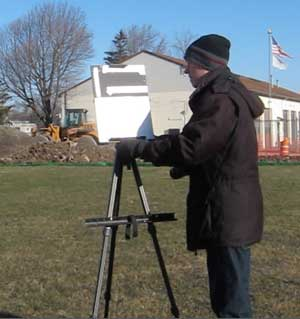 Setting up an easel outdoors.