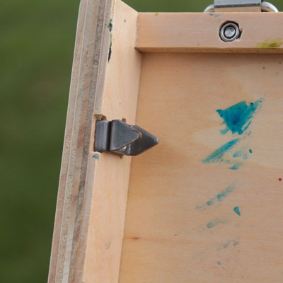 Close up of the clips that hold the painting in place