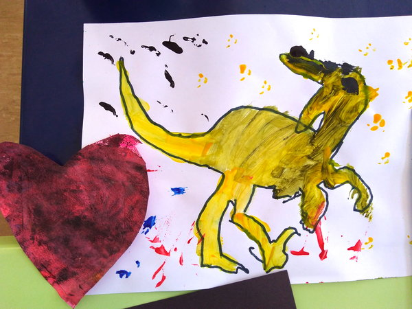 Playing with paint – leaves, handprints and a joyful T-rex