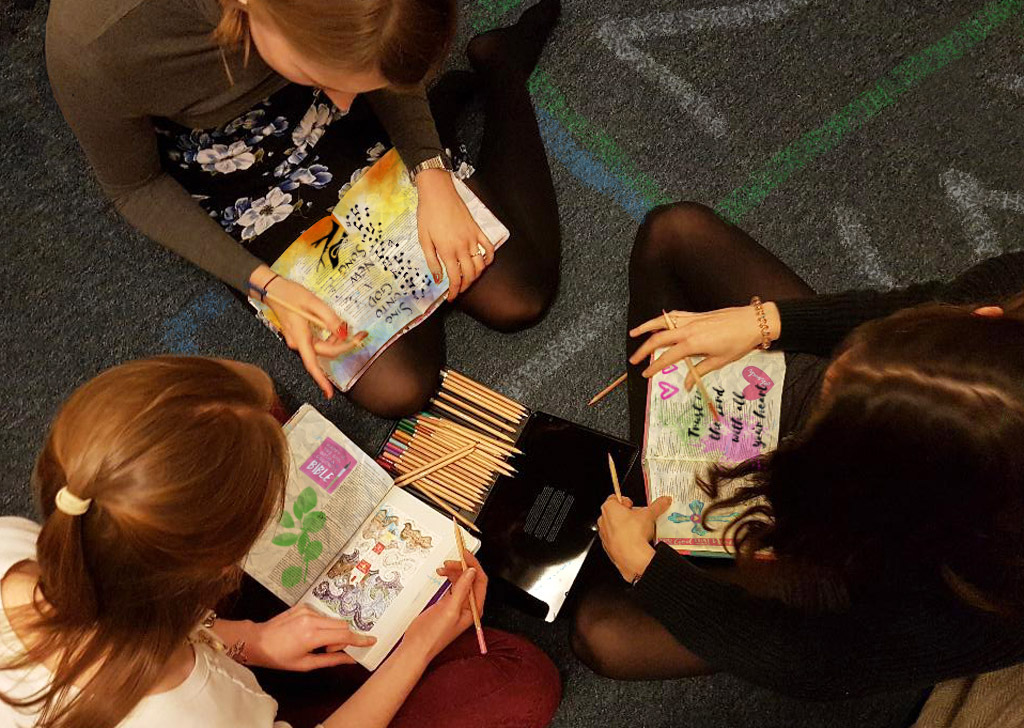 Women Bible Journaling together