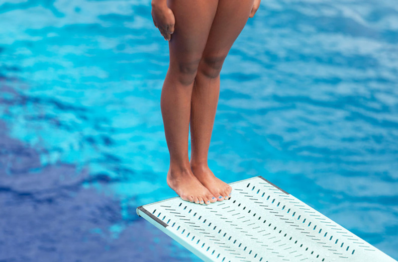 Standing on a diving board for a back fall