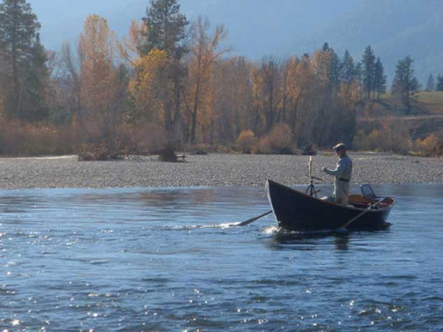 Brent Painting 'En Plein Air' in his driftboat; October on the Bitterroot River, Montana