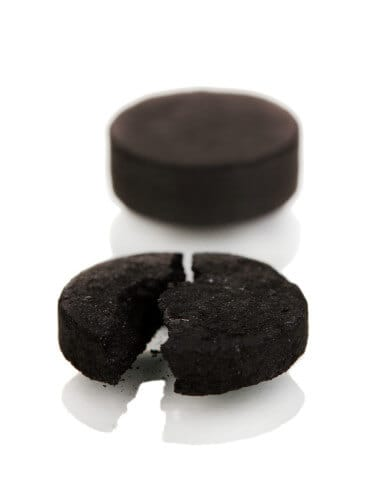 Activated charcoal tablet closeup