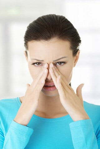 woman with sinusitis, head cold