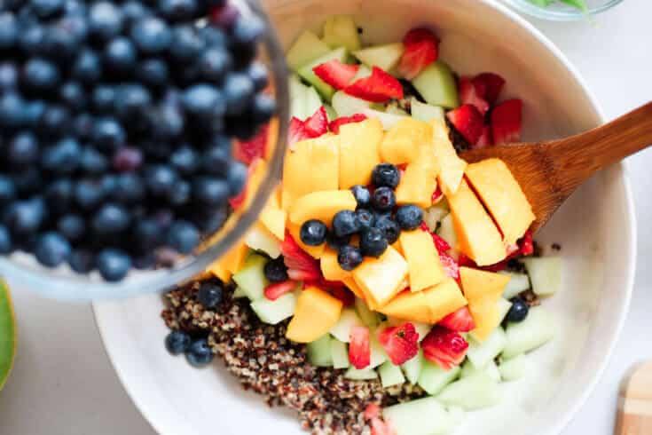 Quinoa salad with fruit process - Dr. Axe