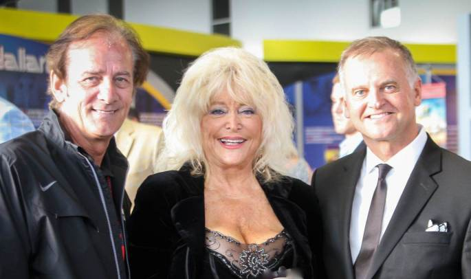 Greg Chernoff, Arie Luyendyk, and Linda Vaughn support the Survivors of Violence Foundation