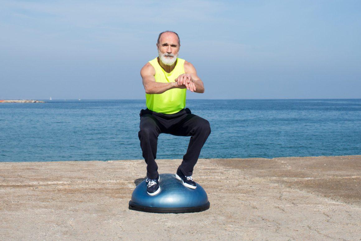 For healthy feet, a man balances on a Bosu ball