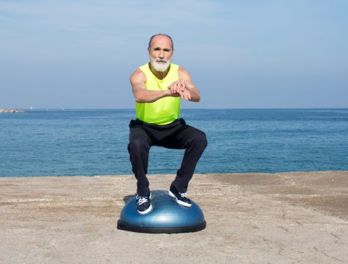 For healthy feet, a man balances on a Bosu ball
