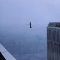 "Philippe Petit crosses a high wire strung between the World Trade Center's twin towers in New York City in ""Man on Wire"""