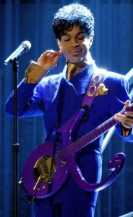 "46TH ANNUAL GRAMMY AWARDS -- Prince performs ""Purple Rain"" as the opening act during the 46th Annual Grammy Awards show, at the Staples Center in Los Angeles, Calif., Sunday, Feb. 8, 2004. LOS ANGELES TIMES PHOTO BY RICHARD HARTOG"