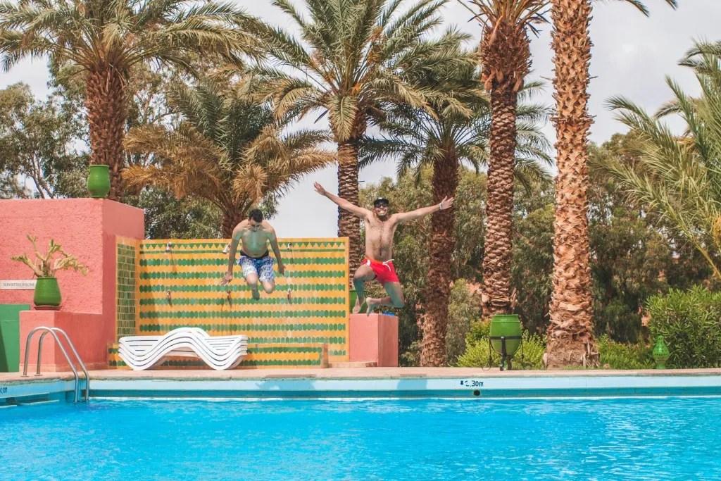 man jumping on pool