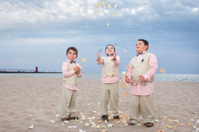 beach weddings, kids tossing flowers petals in air at a beach wedding in michigan