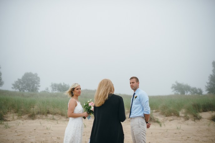 couple eloping in michigan on the beach