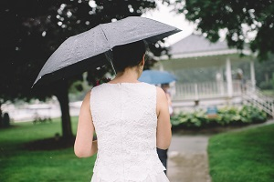 where to elope in michigan, couple elopes in saugtuck, girl with umbrella in rain