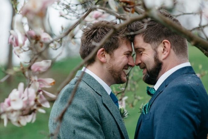 gay couple eloping in the park, LGBT weddings Michigan