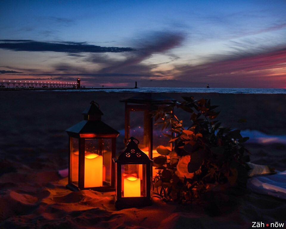 lanterns on a beach at sunset add on option