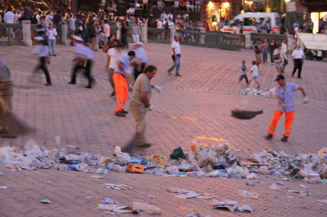 A team of city street sweepers cleans the Piazza del Campo in just a few minutes