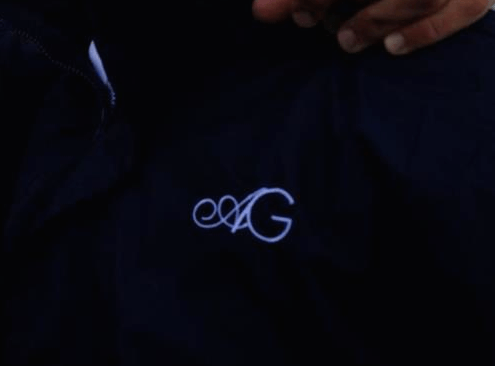 Amal-George Monogram detail on water taxi drivers' jackets