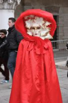 Lady in red costume at Venice Carnival