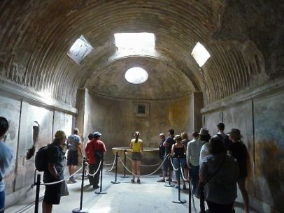 Photo of the painted interior of the roman baths at Pompeii