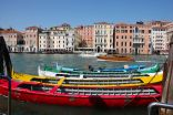 Multi-coloured Venetian boats moored up before the Regata Storica, Venice