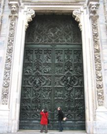 Milan's Duomo doors are intricate panels depicting biblical stories and characters