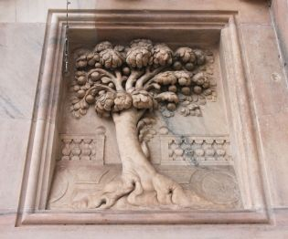 Details lie everywhere with this tree of life carved into a porch wall of Milan's Duomo