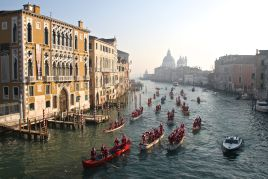 Babbo Natale look-a-likes glide gently down the Grand Canal in Venice