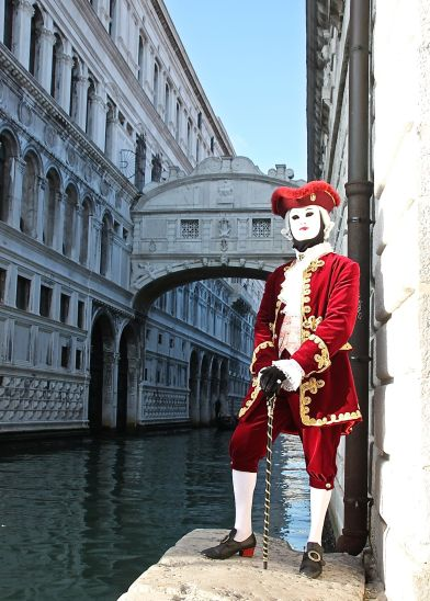 A gentleman strikes a pose in front of Venice's Bridge of Sighs