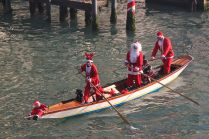 Babbo Natale row Venetian-style down the Grand Canal