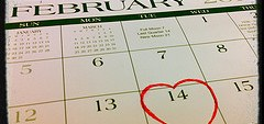 Photo of calendar with red heart 'circling' Feb 14th