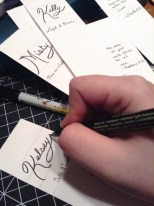 Using a permanent brush pen I inscribe the names with their meaning below in permanent ball point pen.