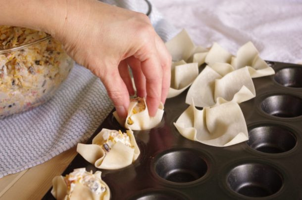 Crab and Cheddar Won Ton Purses Appetizer Easy Recipe - Hand Pinching Won Ton Wrappers Partially Closed