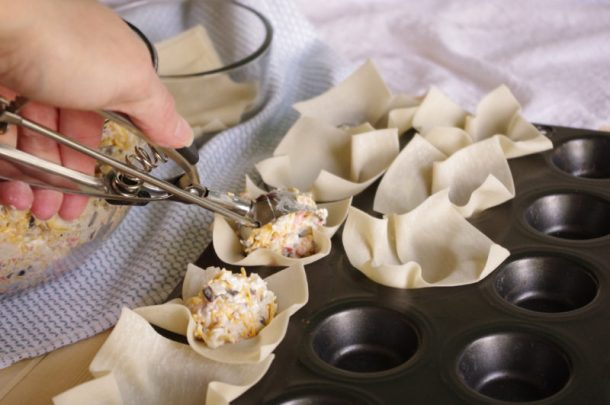 Crab and Cheddar Won Ton Purses Appetizer Easy Recipe - Scooping Filling into Won Ton Wrappers with Cookie Dough Scooper