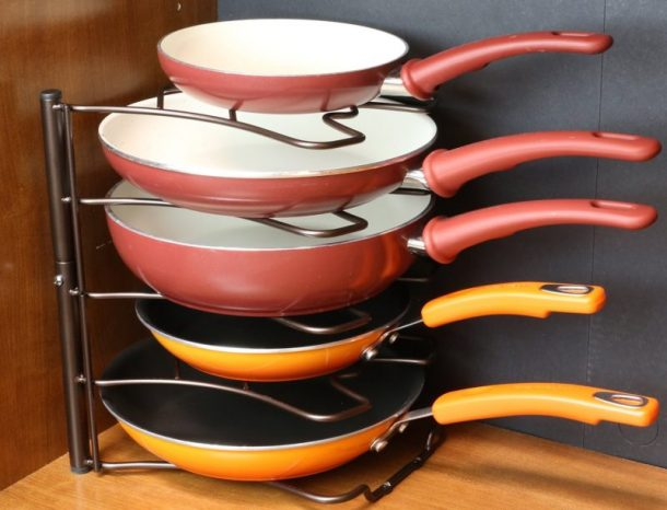 Tips to Organize Every Room in the House - Use a Pan Organizer in Kitchen Cupboards to keep pans from clanking around and to keep them organized