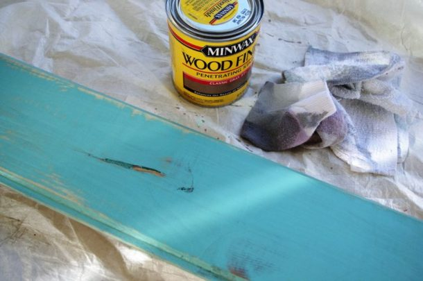 DIY Family Word Art Sign Woodworking Project Tutorial Turquoise Board Stained after Sanding to add subtle weathered look