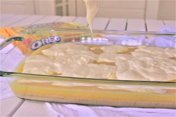 Cheesecake Layer add on top of lemon layer - Lemon Sour Cream Cheesecake Layered Dessert Bars Recipe via Dreaming in DIY