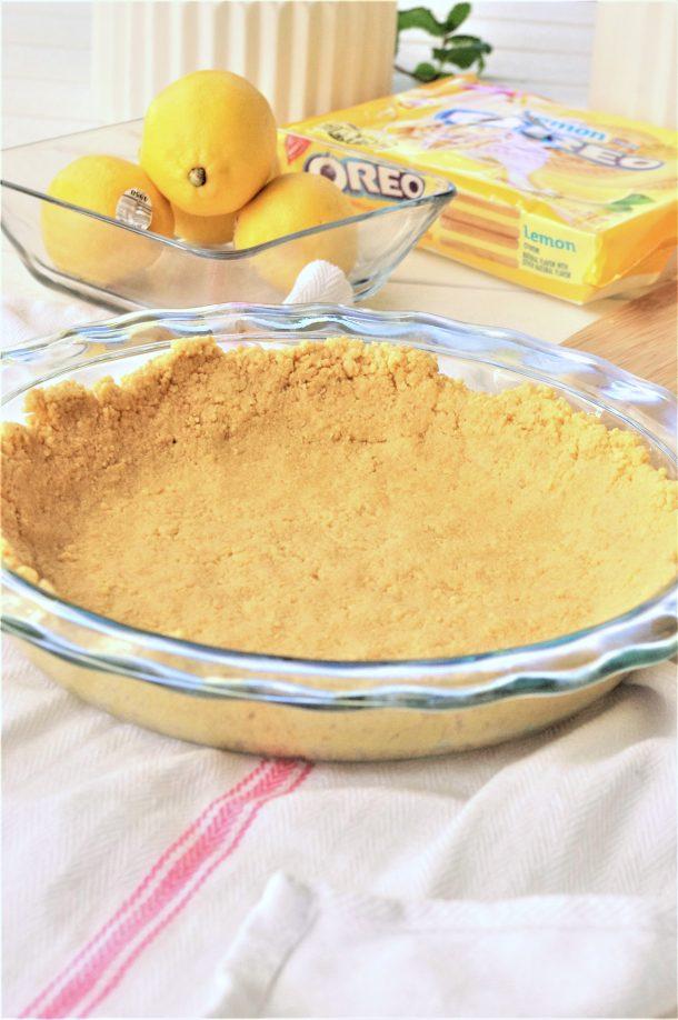 Easy No Bake Lemon Cheesecake Ice Box Pie with Lemon Oreo Crust Dessert Recipe - finger pressed crust via Dreaming in DIY