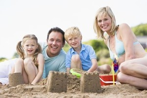making sandcastles at the beach with family