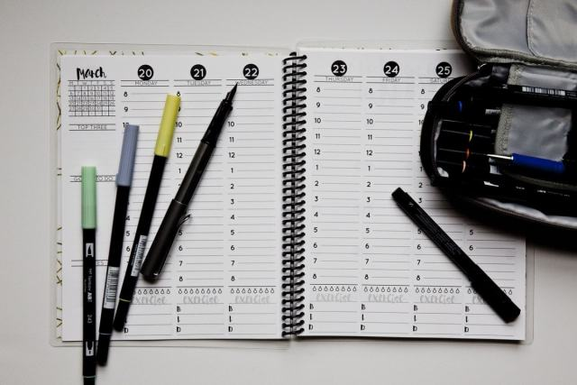 hourly planner with pens on top
