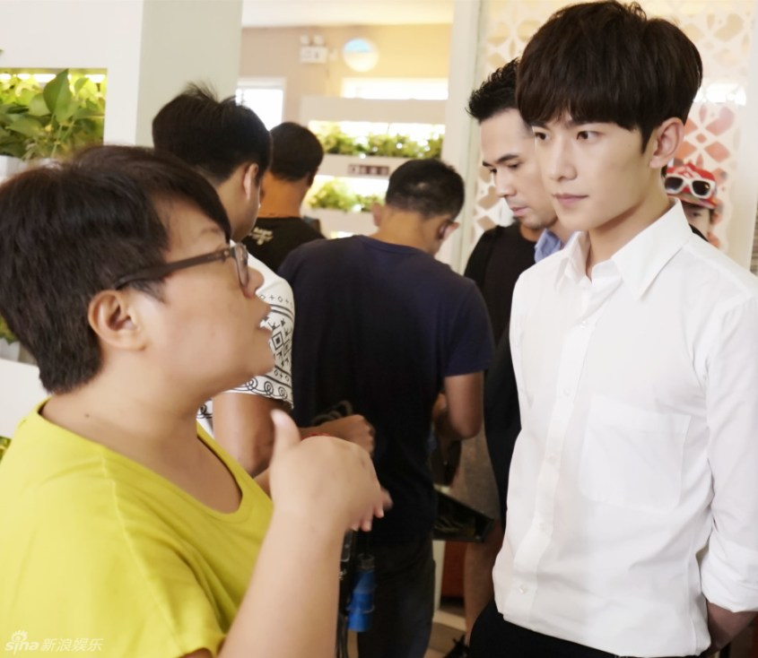 Better look at male lead's face. Wonder who's the guy behind him.