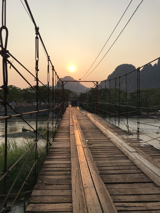 Sunset over a bridge in Vang Vieng